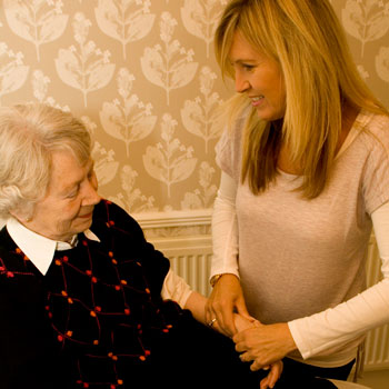 Alison Stuart treating an elderly female patient at Grosvenor Street Physiotherapy