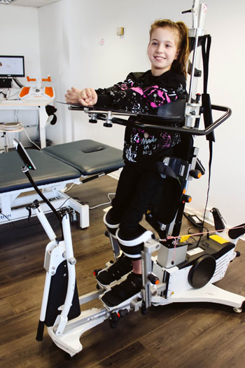 Girl receiving neurological physiotherapy treatment
